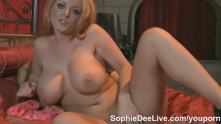 Pornstar slut Sophie Dee plays with her jugs and pussy on cam